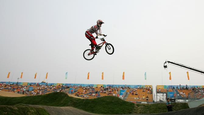 FILE - In this Aug. 20, 2007, file photo, Kyle Bennett of the United States does a bar-twist as he clears a jump during qualifying for the UCI BMX Supercross race at the Olympic BMX course in Beijing. Bennett was killed in an automobile accident early Sunday, Oct. 14, 2012, in eastern Texas. He was 33. (AP Photo/Greg Baker, File)