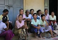 Protesting Myanmar villagers sit outside a monastery which they refuse to leave. Villagers opposing a Chinese co-owned copper mine have vowed to continue their fight against the project despite arrests of demonstrators and orders for the rally to move
