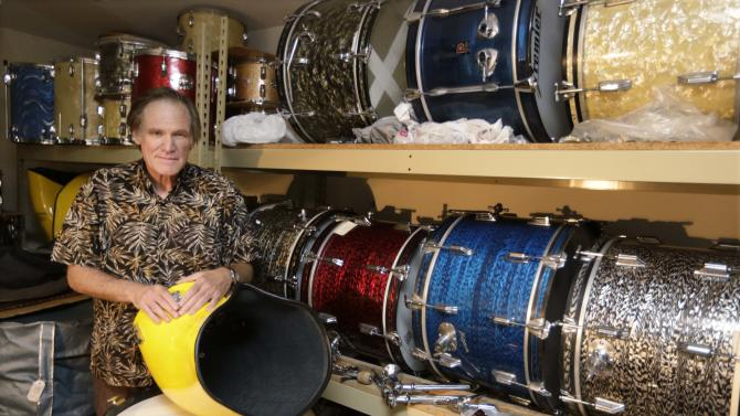 This photo taken Oct. 3, 2013 shows James Glay poses with his collection of vintage drums in Arlington Heights, Ill. Every passing month and unanswered resume dimmed Glay's optimism more. His career in sales was ended by a layoff. So with no job in sight, he joined a growing number of older people and created his own. In a mix of boomer individualism and economic necessity, older Americans have fueled a wave of entrepreneurship, accounting for a growing chunk of new businesses and bringing an income stream to people who otherwise might not have found work. (AP Photo/M. Spencer Green)