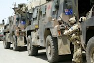 File photo of Australian soldiers in Iraq. Australian Defence Force chief General David Hurley Friday vowed to stamp out abuse in the military following a damning report detailing allegations of rape and sexual assault