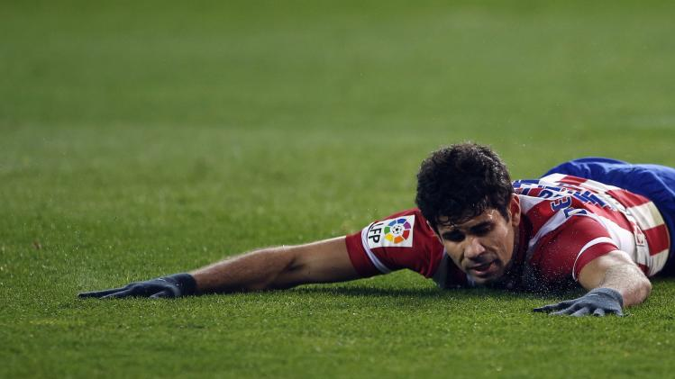 Atletico Madrid's Costa reacts after a missed scoring opportunity against Espanyol during their Spanish first division soccer match at Vicente Calderon stadium in Madrid