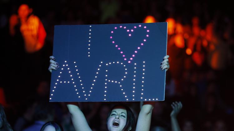 An Avril Lavigne fan sings along during the KISS FM Jingle Ball in Chicago, Illinois