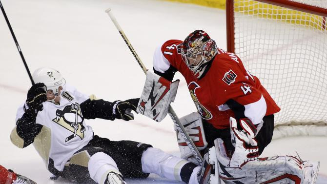 Pittsburgh Penguins' Evgeni Malkin, left, collides into Ottawa Senators goaltender Craig Anderson after being tripped during the first period of Game 4 of their Stanley Cup Eastern Conference semifinal NHL hockey series in Ottawa on Sunday, May 19, 2013. (AP Photo/The Canadian Press, Patrick Doyle)