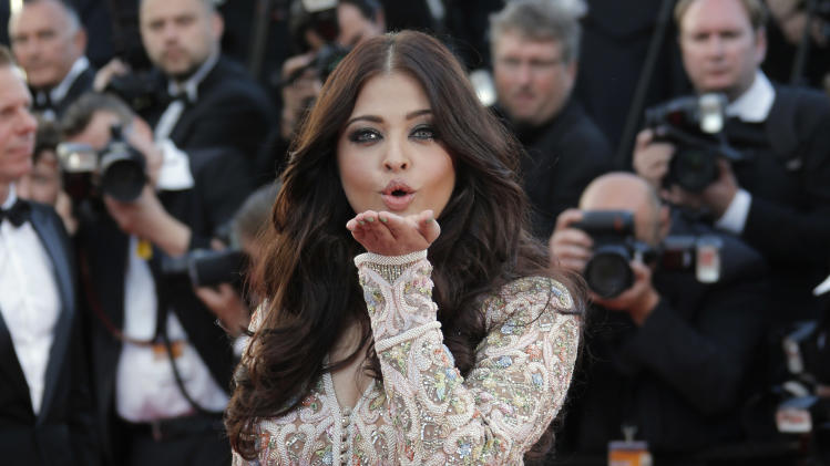 Actress Aishwarya Rai poses for photographers as she arrives for the screening of Blood Ties at the 66th international film festival, in Cannes, southern France, Monday, May 20, 2013. (AP Photo/Francois Mori)