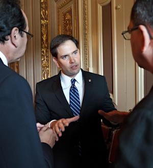 In this photo taken May 24, 2012, Sen. Marco Rubio, R-Fla. has a conversation just off the Senate floor on Capitol Hill in Washington. Rubio is planning a swing-state summer bus tour that will also roll through South Carolina, the early presidential primary battleground.  (AP Photo/J. Scott Applewhite)