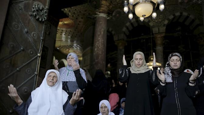 Palestinian women pray on the third Friday of the holy month of Ramadan inside the Dome of the Rock in Jerusalem's Old City