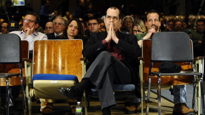 FILE - In this Jan. 30, 2013 file photo, David Wheeler, father of Sandy Hook School shooting victim Benjamin, listens to a legislative hearing of a task force on gun violence and children's safety at Newtown High School in Newtown, Conn. Connecticut lawmakers announced a deal Monday, April 1, 2013 on what they called some of the toughest gun laws in the country that were proposed after the December mass shooting in the state, including a ban on new high-capacity ammunition magazines like the ones used in the massacre that left 20 children and six educators dead. (AP Photo/Jessica Hill, File)