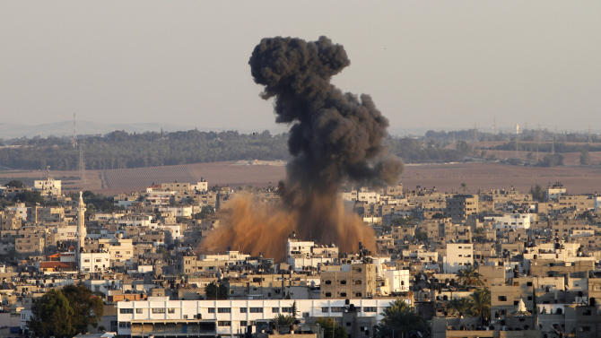 Smoke rises following an Israeli attack on Gaza City, Thursday, Nov. 15, 2012. Israel barraged the Gaza Strip with airstrikes and shelling Wednesday and killed the Hamas military chief in a targeted strike, launching a campaign aimed at stopping rocket attacks from Islamic militants. The assault killed 10 other Palestinians, including two children and seven militants. On Thursday, militant rockets fired into Israel killed three Israelis, raising the likelihood of a further escalation. (AP Photo/Hatem Moussa)