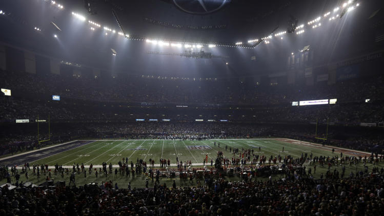 Half the lights are out in the Superdome during a power outage in the second half of the NFL Super Bowl XLVII football game between the San Francisco 49ers and Baltimore Ravens on Sunday, Feb. 3, 2013, in New Orleans. (AP Photo/Gerald Herbert)