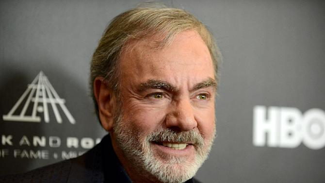 "This Thirsday, April 18, 2013 photo shows Neil Diamond at the Rock and Roll Hall of Fame Induction Ceremony at the Nokia Theatre  in Los Angeles. Diamond said he's happy his ""Sweet Caroline,"" a staple of Boston Red Sox games, can provide comfort after the Boston Marathon bombing. ""There is a lot of comfort that music can offer,"" Diamond told The Associated Press. ""In this particular situation, I'd much rather it not have happened than for `Sweet Caroline' to become part of it. But it's obviously offering comfort to people and I feel good about that.""  (Photo by Jordan Strauss/Invision)"