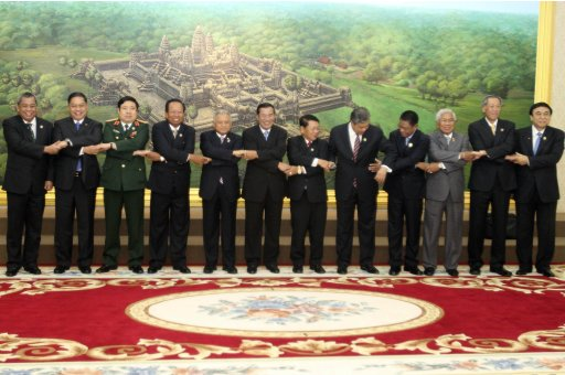 Cambodia's Prime Minister and other Defence Ministers pose for a photograph during the opening ceremony of the 6th ASEAN  Defence Ministers' meeting at the Peace Palace in Phnom Penh