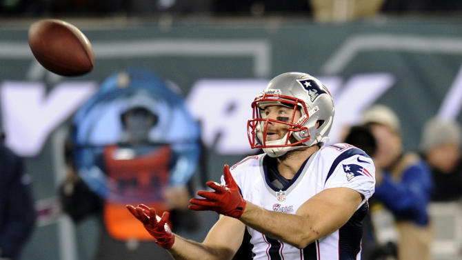 New England Patriots wide receiver Julian Edelman (11) catches a 56-yard pass for a touchdown during the first half of an NFL football game against the New York Jets, Thursday, Nov. 22, 2012, in East Rutherford, N.J. (AP Photo/Bill Kostroun)