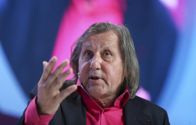 Former world No.1 professional tennis player Ilie Nastase of Romania speaks during the Doha GOALS forum in Doha
