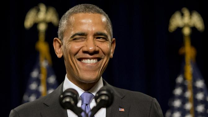 President Barack Obama winks as he is welcomed before speaking to the House Democratic Issues Conference in Cambridge, Md., Friday, Feb. 14, 2014. The president said top priorities for Congress should be increasing the minimum wage and reforming immigration. Obama told a House Democratic retreat Friday that the party needs to stand up for the American dream of getting ahead. (AP Photo/Jacquelyn Martin)