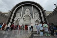Muslims are seen leaving a mosque in Kuala Lumpur. Malaysia on Sunday deported a young Saudi journalist who is wanted in his home country over a Twitter post about the Prophet Mohammed that sparked calls for his execution, according to an official