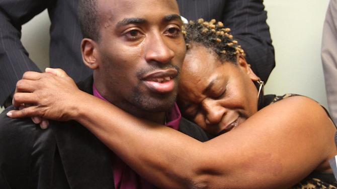 Aletha Smith embraced her son, truck driver Jabin Akeem Bogan, 27, during a press conference shortly after re-entering the U.S. after his release from a Mexican prison Friday Nov. 23, 2012. The Dallas trucker imprisoned for seven months in Mexico on accusations that he tried to smuggle assault rifle ammunition into the country broke down in tears Friday when he returned to the U.S., saying he had at times given up hope. (AP Photo/El Paso Times, Victor Calzada)