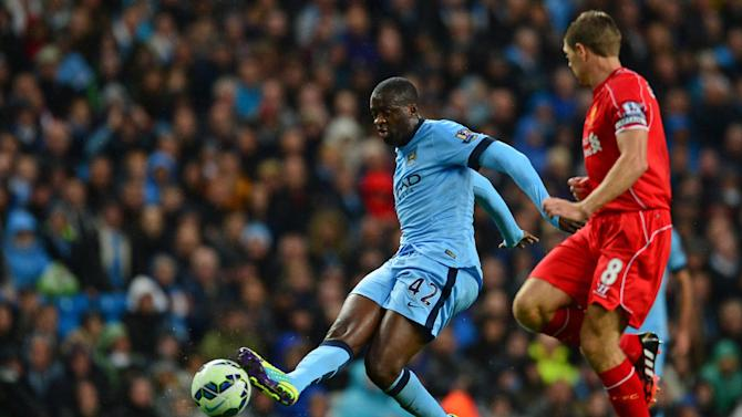 Manchester City's Ivorian midfielder Yaya Toure (L) passes the ball during the English Premier League football match between Manchester City and Liverpool at the Etihad Stadium in Manchester on August 25, 2014