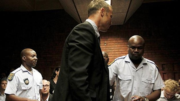 South African &#39;Blade Runner&#39; Oscar Pistorius (C) is escorted by police during his court appearance in Pretoria February 15, 2013 (Reuters)