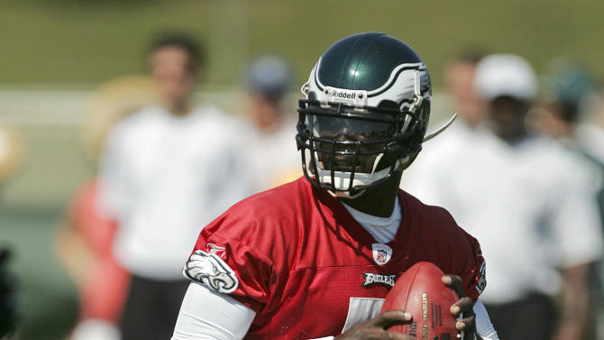 Philadelphia Eagles quarterback Michael Vick runs out of the pocket during the morning session of NFL football training camp at Lehigh University in Bethlehem, Pa. on Saturday, July 30, 2011. (AP Photo/Rich Schultz)