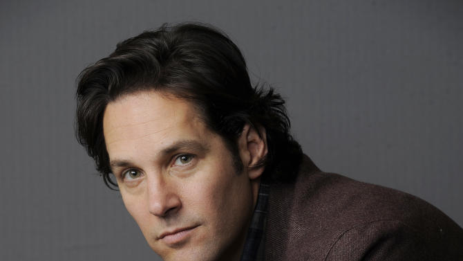 """In this Wednesday, Dec. 12, 2012 photo, Paul Rudd, a cast member in the film """"This is 40,"""" poses for a portrait at The Four Seasons Hotel in Beverly Hills, Calif. In """"This Is 40,"""" Rudd's character is having a full-on mid-life crisis, dreaming of living a different life while his business struggles and his marriage falters. Rudd stars with Apatow's real-life wife, Leslie Mann, and the couple's two daughters, Maude and Iris, in the comedy in theaters Friday, Dec. 21. (Photo by Chris Pizzello/Invision/AP)"""