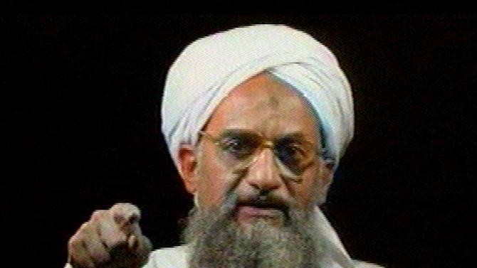 FILE - In this file image from television transmitted by the Arab news channel Al-Jazeera on Monday Jan. 30, 2006, Al-Qaida's then deputy leader Ayman al-Zawahri gestures while addressing the camera. Al-Qaida's central leadership broke with one of its most powerful branch commanders, who in defiance of its orders spread his operations from Iraq to join the fighting in Syria and fueled bitter infighting among Islamic militant factions in Syria's civil war. The break, announced in a statement Monday, appeared to be an attempt by Al-Zawahri, to establish control over the feuding militant groups in Syria and stem the increasingly bloody reprisals among them. (AP Photo/Al-Jazeera, File)
