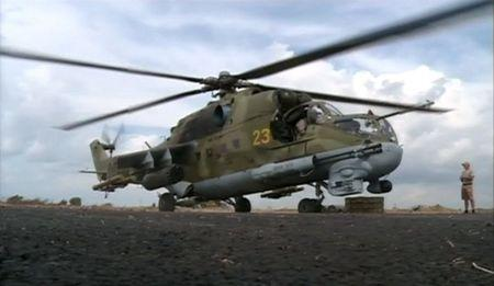 A still image shows a Russian air force helicopter on the tarmac of Heymim air base near the Syrian port town of Latakia