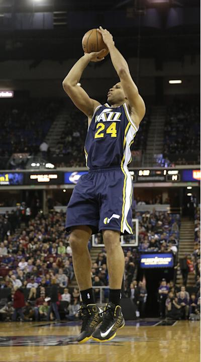 Utah Jazz guard Richard Jefferson shoots d   during the first quarter of an NBA basketball game against the Sacramento Kings in Sacramento, Calif., Wednesday, Dec. 11, 2013.  The Jazz won 122-101