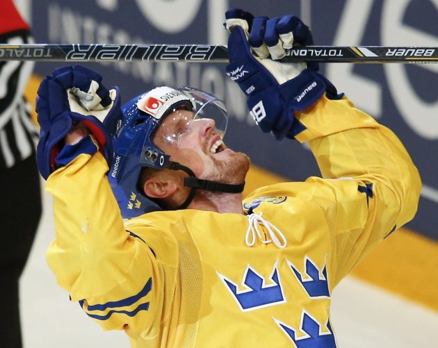 Sweden's Henrik Sedin celebrates a goal against Switzerland during their 2013 IIHF Ice Hockey World Championship final match at the Globe Arena in Stockholm