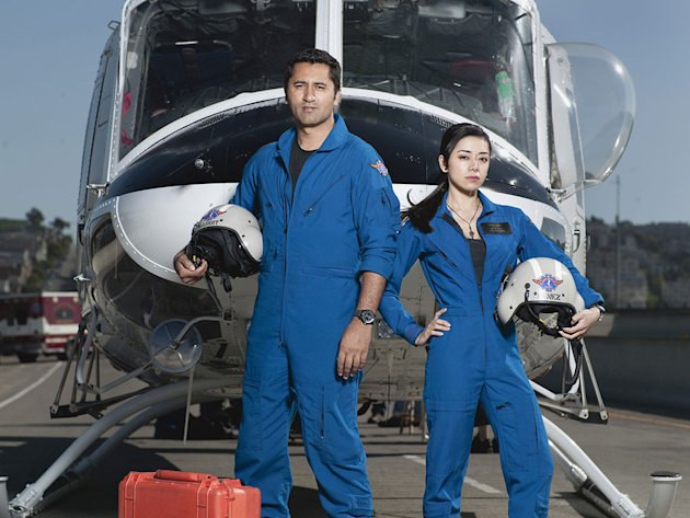Cliff Curtis as &quot;Rabbit&quot; and Aimee Garcia as Marisa in the NBC series Trauma. 