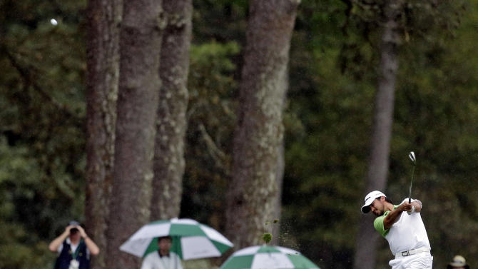 Jason Day, of Australia, hits off the 14th fairway during the fourth round of the Masters golf tournament Sunday, April 14, 2013, in Augusta, Ga. (AP Photo/Charlie Riedel)