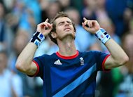 Britain's Andy Murray celebrates victory in his men's singles semifinal round match against Serbian's Novak Djokovicat in the 2012 London Olympic Games at the All England Tennis Club in Wimbledon, southwest London, on August 3, 2012. AFP PHOTO/ Martin Bernetti