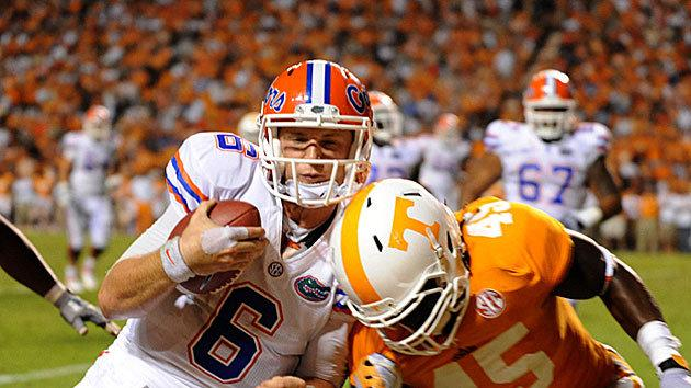 Tennessee linebacker AJ Johnson is driving Florida quarterback Jeff Driskel out of bounds
