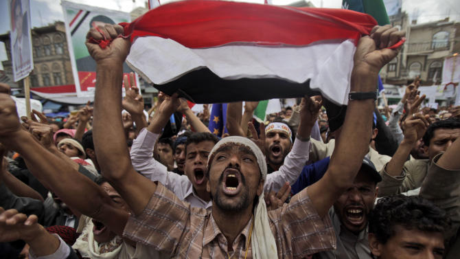 Anti-government protestors react during a demonstration demanding the resignation of Yemeni President Ali Abdullah Saleh, in Sanaa, Yemen, Sunday, April 10, 2011. Government forces shot bullets and tear gas at demonstrators in Yemen's capital and another city on Saturday as longtime President Ali Abdullah Saleh resisted a diplomatic push for the resignation that hundreds of thousands of his own people were demanding in the streets.  (AP Photo/Muhammed Muheisen)