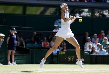 Maria Sharapova of Russia hits a shot during her match against Serena Williams of the U.S.A. at the Wimbledon Tennis Championships in London
