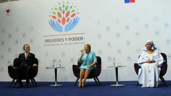 Chile's President Michelle Bachelet, center, waves to the audience, alongside United Nations Secretary-General Ban Ki-Moon, left, and UN Women Executive Director Phumzile Mlambo-Ngcuka during a conference organized by UN Women in Santiago, Chile, Friday, Feb. 27, 2015. (AP Photo/Luis Hidalgo)