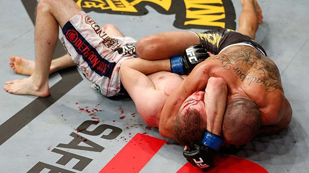 Renan Barao submits Michael McDonald with an arm triangle. (Getty)