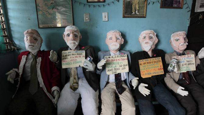 Handmade puppets are seen inside the home of Hector Villareyna, a craftsman from Leon city, in Managua
