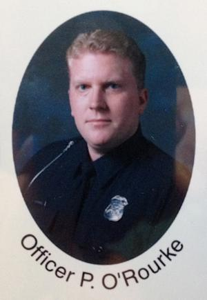 This photo provided by the West Bloomfield Police shows officer Pat O'Rourke. Police evacuated an upscale neighborhood and surrounded a house Monday in suburban Detroit, hours after O'Rourke was fatally shot while responding to a 911 call about trouble at the address. O'Rourke was shot about 10 p.m. Sunday inside the home in West Bloomfield Township and later died at a hospital, police Lt. Timothy Diamond said. (AP Photo/West Bloomfield Police)