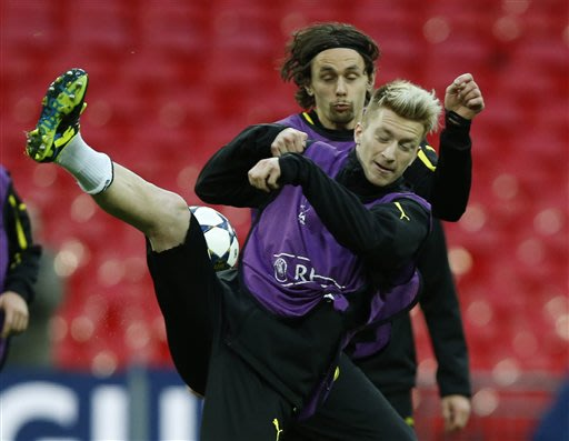 Dortmund's Neven Subotic of Serbia, left,  Marco Reus and in action during a training session at Wembley Stadium in London, Friday May 24, 2013. Dortmund will face fellow German soccer team Bayern Mun