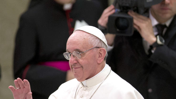 Pope Francis waves as he arrives at the Paul VI hall for a meeting with the media, at the Vatican Saturday, March 16, 2013. (AP Photo/Alessandra Tarantino)