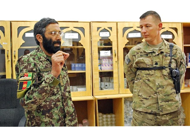 Afghan National Army Col. Shazad Gul speaks to American adviser Lt. Col. Thomas Sutton, of the 101st Airborne Division, on Saturday, May 26, 2013 at the medical clinic at Camp Parsa in Khost Province,