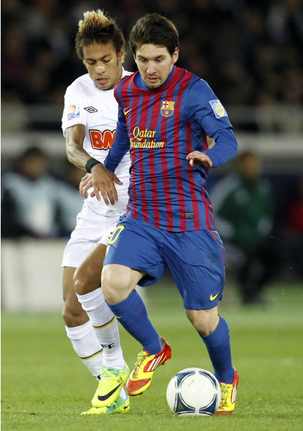 Spain's FC Barcelona midfielder Lionel Messi, right, and Brazil's Santos FC forward Neymar vie for the ball during the final at the Club World Cup soccer tournament in Yokohama, near Tokyo, Japan, Sun
