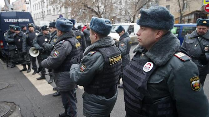Police officers stand guard outside a court where Russian martial arts champion Rasul Mirzaev was found guilty of involuntary manslaughter, Moscow, Russia, Tuesday, Nov. 27, 2012. Mirzayev was sentenced to two years of house arrest over the death of a man he had punched outside a club. (AP Photo/Misha Japaridze)