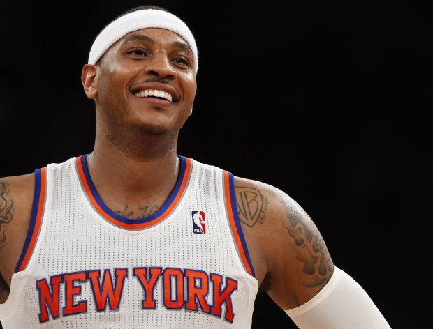 New York Knicks forward Carmelo Anthony smiles in the second half of their NBA basketball game  against the Toronto Raptors at Madison Square Garden in New York, March 23, 2013.    REUTERS/Adam Hunger  (UNITED STATES - Tags: SPORT BASKETBALL)