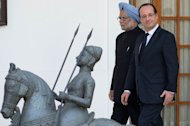 France's President Francois Hollande (R) with Indian Prime minister Manmohan Singh at a ceremony at Hyderabad House in New Delhi on February 14, 2013. The leaders of France and India said negotiations on a $12 billion fighter jet contract, the world's biggest defence deal, were making good progress after talks Thursday in New Delhi