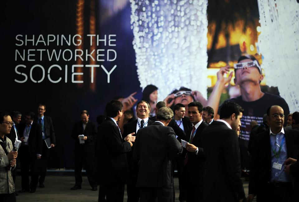 Participants attend the Mobile World Congress, the world's largest mobile phone trade show, in Barcelona, Spain, Tuesday, Feb. 28, 2012. (AP Photo/Manu Fernandez)