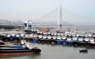 Fishing boats are berthed in a port in Haikou, China's Hainan province, as powerful Typhoon Utor approaches on August 13, 2013. Utor is predicted to make landfall on Wednesday night or Thursday morning, according to China's state news agency Xinhua