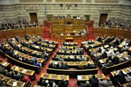 Greek Prime Minister Antonis Samaras gives a final speech at the Greek parliament in Athens prior to the confidence vote to the government. The coalition government of Antonis Samaras won the largely symbolic confidence vote, winning a comfortable mandate to tackle the country's two-year-old crisis