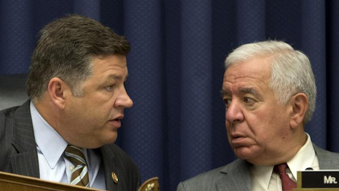 FILE - In this May 16, 2013, file photo, House Transportation and Infrastructure Committee Chairman Rep. Bill Shuster, R-Pa., left, talks to then ranking Democrat Rep. Nick Rahall, D-W.Va. on Capitol Hill in Washington. The Obama administration is on the verge of proposing long-awaited rules for commercial drone operations in the U.S. sky, but key decisions on how much access to grant drones are likely to come from Congress next year. (AP Photo/Carolyn Kaster, File)