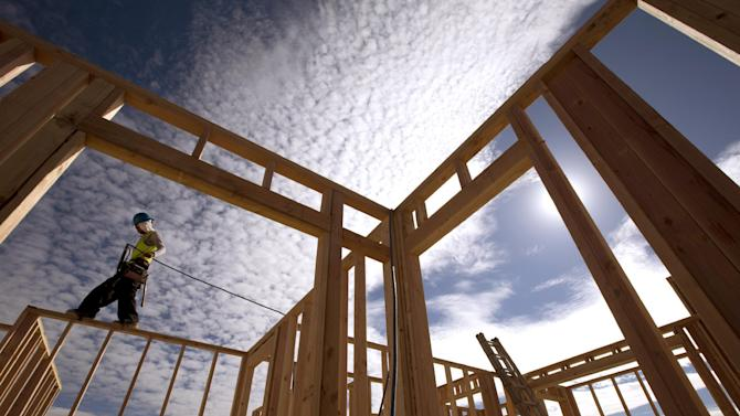 "FILE - In this Friday, Nov. 16, 2012 file photo, construction worker Elabert Salazar works on a house frame for a new home in Chula Vista, Calif. If Washington lawmakers can get past the ""fiscal cliff,"" many analysts say that the outlook for stocks in 2013 is good, as a recovering housing market and an improving jobs outlook helps the economy maintain a slow, but steady recovery. (AP Photo/Gregory Bull, File)"